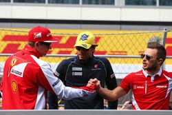 (L to R): Kimi Raikkonen, Ferrari with Felipe Nasr, Sauber F1 Team and Will Stevens, Manor F1 Team o