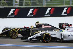 Pastor Maldonado, Lotus F1 E23 and Felipe Massa, Williams FW37 at the start of the race