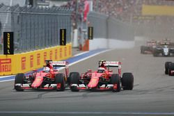 (L to R): Sebastian Vettel, Ferrari SF15-T and team mate Kimi Raikkonen, Ferrari SF15-T battle for position