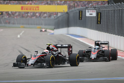 Jenson Button, McLaren MP4-30 leads team mate Fernando Alonso, McLaren MP4-30
