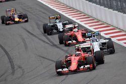 Kimi Raikkonen, Ferrari and Valtteri Bottas, Williams and Sebastian Vettel, Ferrari