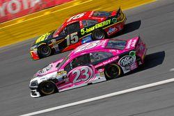 Jeb Burton, BK Racing Toyota and Clint Bowyer, Michael Waltrip Racing Toyota