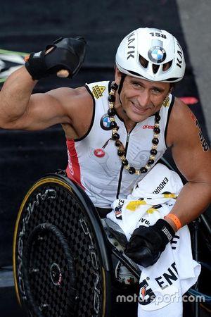 Alex Zanardi celebrates after winning his class in the Hawaii Ironman triathlon