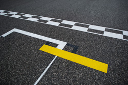 The start / finish line and pole position grid slot