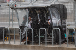 The Mercedes AMG F1 pit gantry during heavy rain in the second practice session