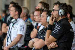 Mercedes AMG F1 team watch the rain fall in the second practice session