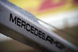 Rain drops on a Mercedes AMG F1 logo
