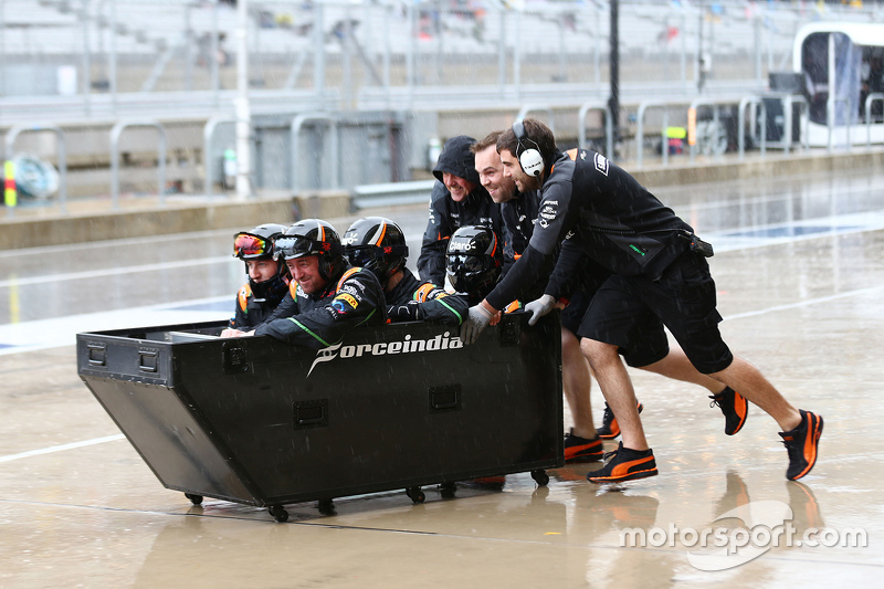 Sahara Force India F1 Team mechanics have some fun in the pits