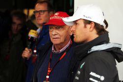 (L to R): Niki Lauda, Mercedes Non-Executive Chairman with Nico Rosberg, Mercedes AMG F1
