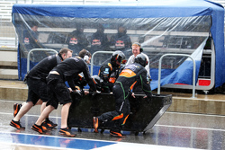 Sahara Force India F1 Team mechanics have some fun in the wet pit lane