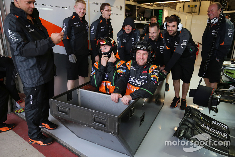 The Sahara Force India F1 Team have some fun during a wet qualifying session