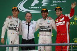 The podium: Second place Nico Rosberg, Mercedes AMG F1, Race winner and World Champion Lewis Hamilton, Mercedes AMG F1, and third place Sebastian Vettel, Ferrari