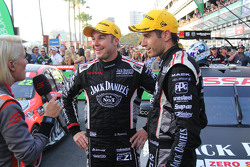 Second place Rick Kelly and David Russell, Nissan Motorsports with the media