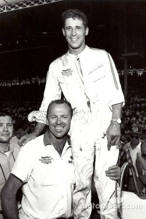 Mario Andretti celebrates second place in the Hoosier Hundred with Clint Brawner