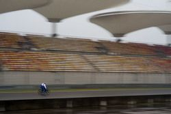 Toyota Racing drivers ride the circuit on bicycle