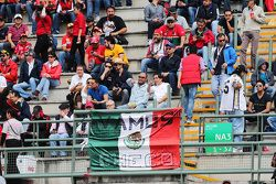Fans in the grandstand and a Mexican flag
