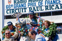 Podium: winner Alan Jones, Williams, second place Didier Pironi, third place Jacques Laffite
