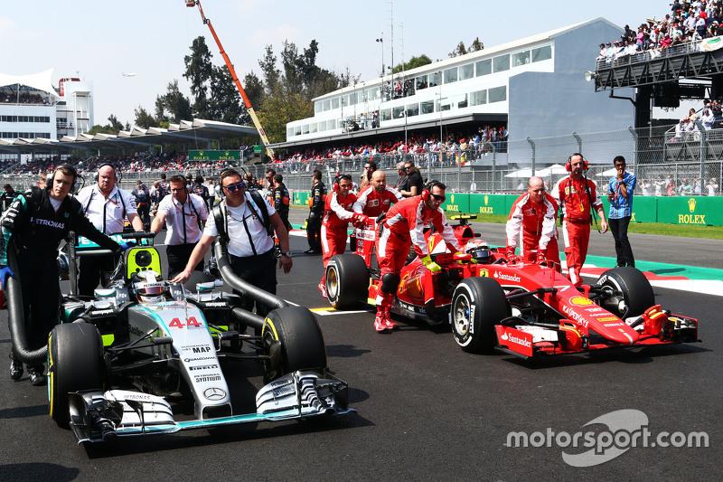 Lewis Hamilton, Mercedes AMG F1 W06 and Kimi Raikkonen, Ferrari SF15-T on the grid