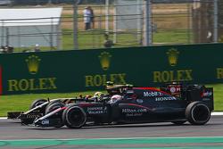 Jenson Button, McLaren MP4-30 and Pastor Maldonado, Lotus F1 E23 battle for position