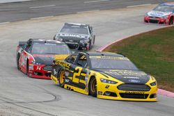 Brad Keselowski, Team Penske Ford and Brett Moffitt, Front Row Motorsports Ford