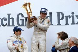 Podium: race winner Alan Jones, Williams, second place Jody Scheckter, Ferrari, third place Jacques