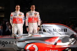 Gary Paffett and Pedro de la Rosa pose with the new McLaren Mercedes MP4-23