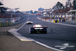 Aston Martin AMR1 and Nissan R 89 C on the grandstands strait.