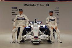 Robert Kubica and Nick Heidfeld pose with the new BMW Sauber F1.08