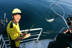 Aaron Lim, driver of A1 Team Malaysia catches a fish