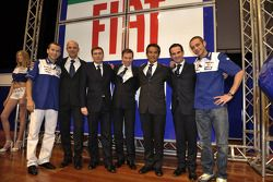 Jorge Lorenzo and Valentino Rossi pose with Fiat Yamaha team members