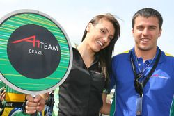 A Grid Girl with Clemente de Faria Jr., driver of A1 Team Brazil