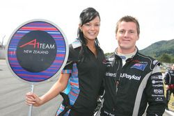 Jonny Reid, driver of A1 Team New Zealand with his grid girl