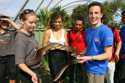 Jade MacRae and Robbie Kerr, driver of A1 Team Great Britain with a snake