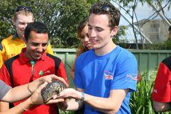 Robbie Kerr, driver of A1 Team Great Britain handles a lizard