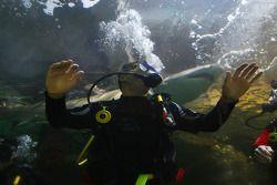 Jonny Reid, driver of A1 Team New Zealand at the shark dive tank at Ocean world, Sydney