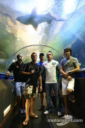 A1GP Drivers at the shark dive tank at Ocean world, Sydney