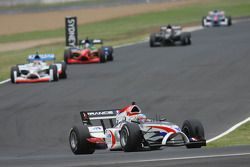 Loic Duval, driver of A1 Team France leads Neel Jani, driver of A1 Team Switzerland