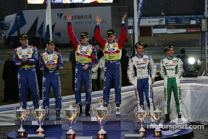 Podium: winners Jari-Matti Latvala and Miikka Anttila, second place Mikko Hirvonen and Jarmo Lehtine