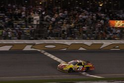 Michael Annett takes the checkered flag