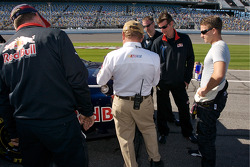 A.J. Allmendinger looks on as his Red Bull Toyota undergoes tech inspection