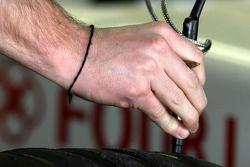 A bridgestone tyre engineer, checks Anthony Davidson, Super Aguri F1 Team