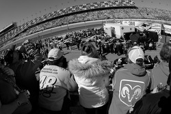 Fans watch garage activity as the teams prepare for the duel races