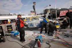 Best Buy Dodge crew members repair the car of Elliott Sadler