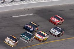 Dale Jarrett leads a group of cars in turn 4