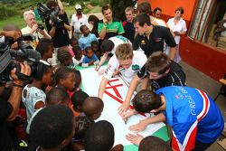 A1GP Drivers sign a A1GP flag, Food4Africa, Mount Moriah Ministries Care and Support Centre, a charitable organisation that cares for disadvantaged children
