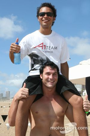 Adrian Zaugg, driver of A1 Team South Africa gets a lift from one of the Natal Sharks