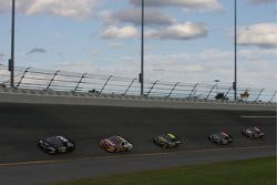 Bobby Labonte leads a group of cars