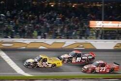Todd Bodine takes the checkered flag in front of Kyle Busch and Johnny Benson