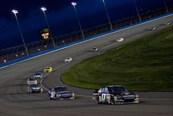 Matt Kenseth leads a pack out of turn four