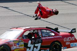 Race winner Carl Edwards celebrates with this usual backflip